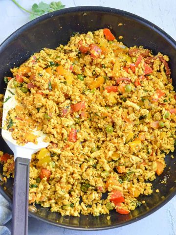 Healthy curried tofu scramble cooked in the pan