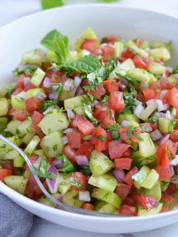 a close up click of persian salad