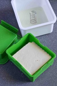 tofu pressed to drain extra water