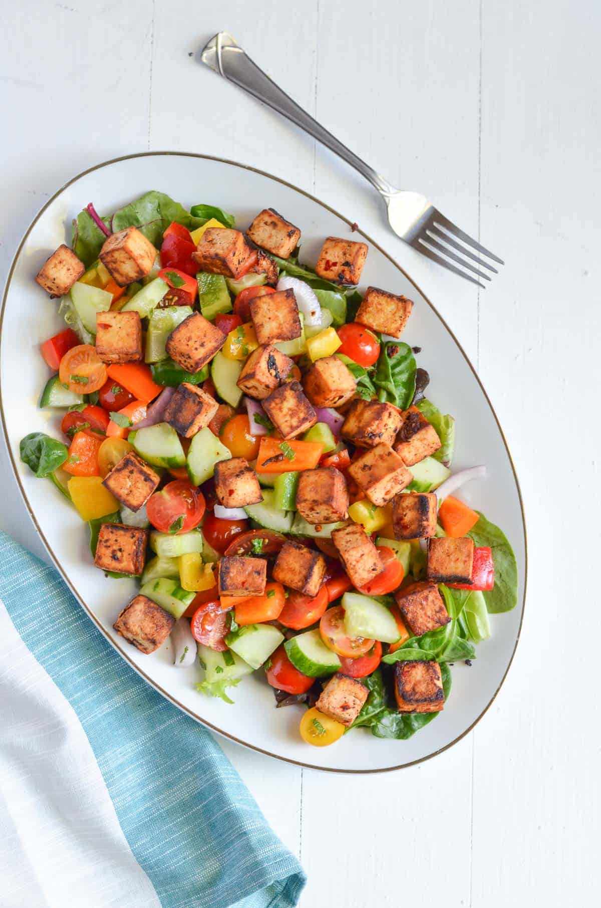 panzanella salad is served in oval platter.