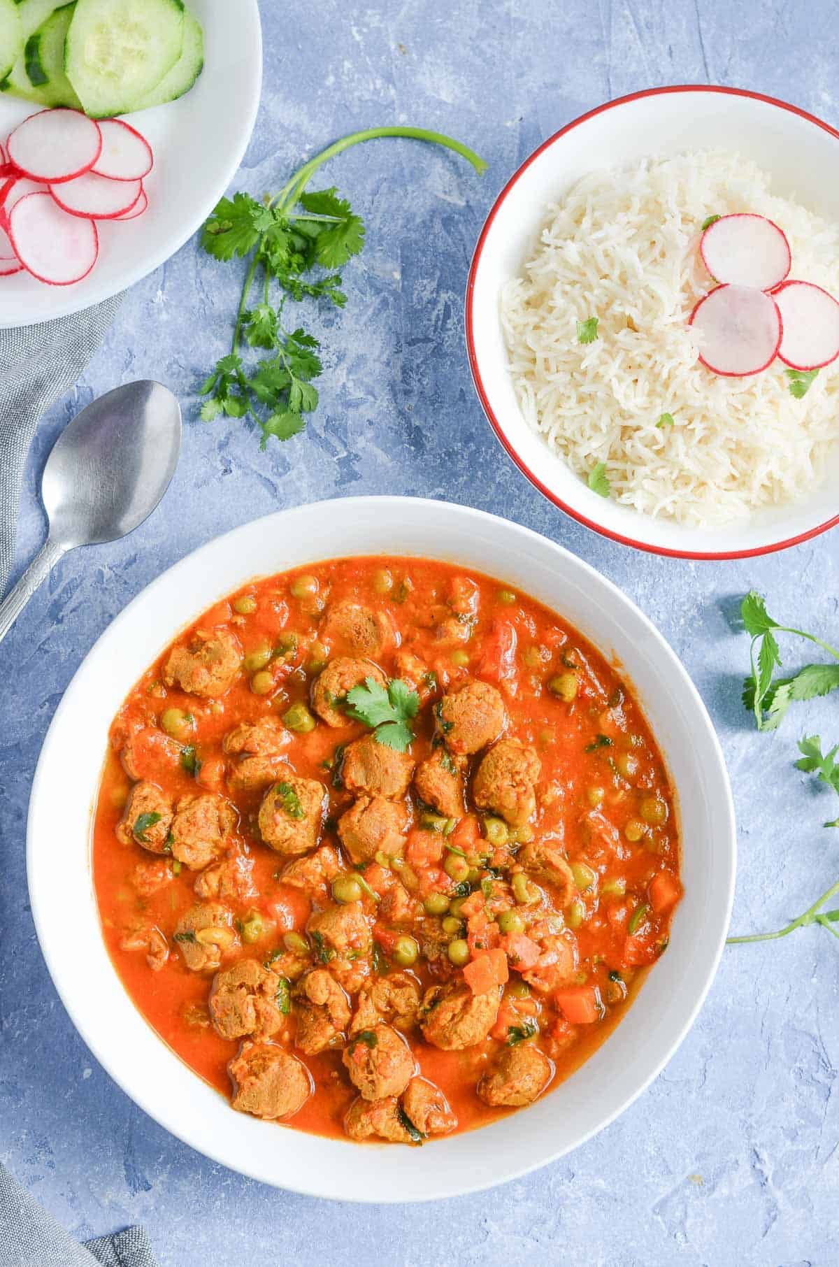 overhead click of veggie chunks curry served in white bowl with plain rice.