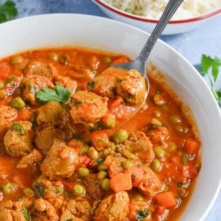 a closeup click of spoonful veggie chunks curry