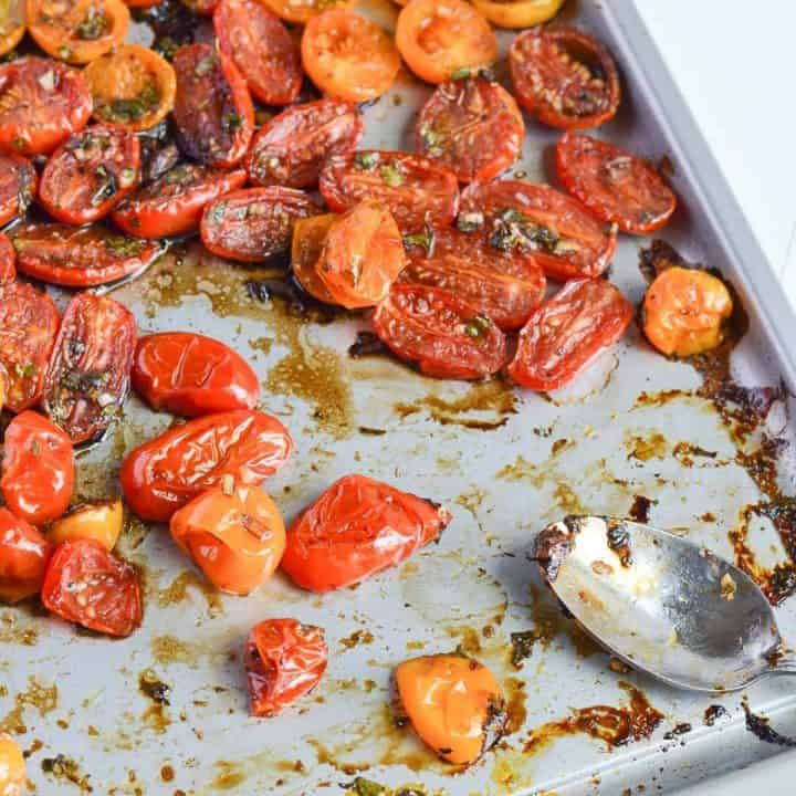 oven-roasted cherry tomatoes with balsamic vinegar in sheet pan