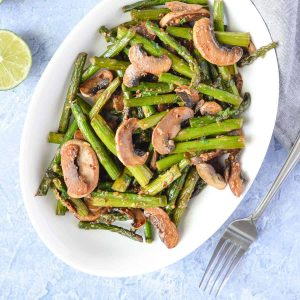 overhead click of sauteed asparagus with mushrooms