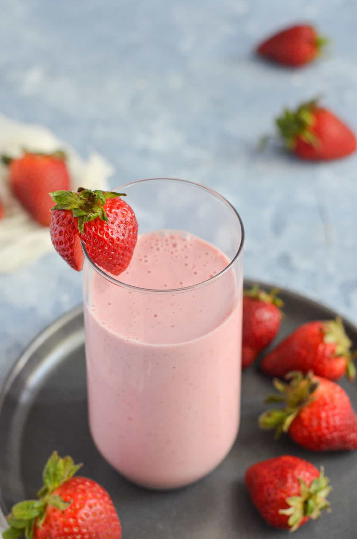 a close up view of strawberry lassi with greek yogurt
