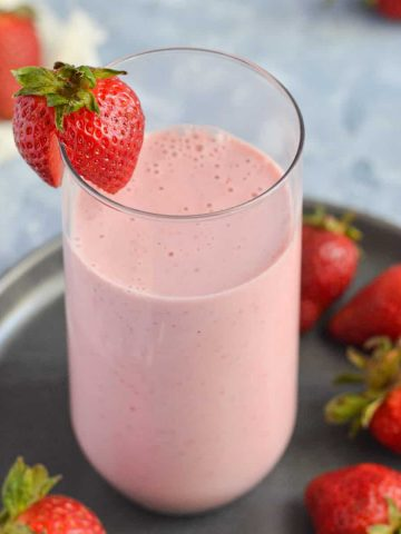 a side view of strawberry lassi