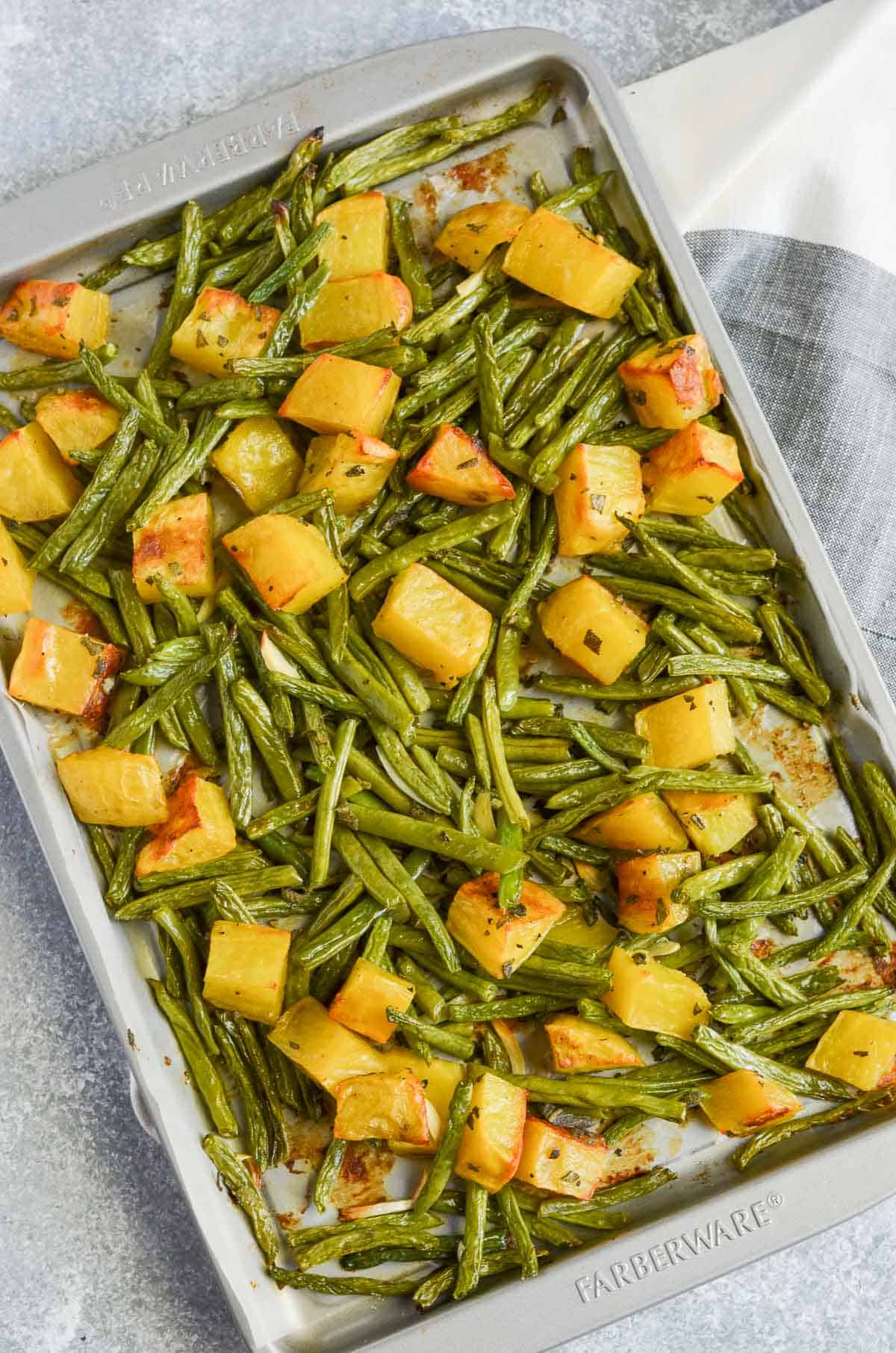 oven roasted potatoes, green beans and sage in the sheet pan.